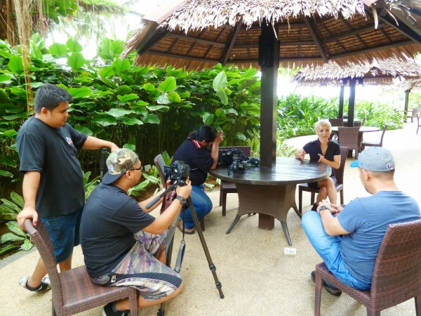 Filming a segment for Asia:Food.Travel.Mystery in the resort grounds.