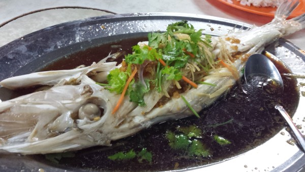 Ikan Patin steamed with soy sauce.