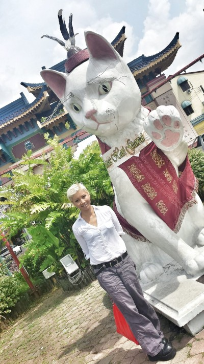 "Photo with a kucing in Kuching. FYI Kuching is the old Malay spelling for the word ""cat""."