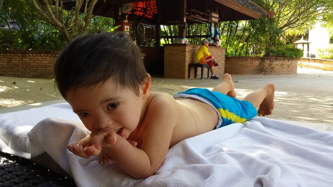 Baby Noah feeling much better at the hotel pool