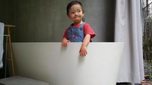 Baby Noah in the bathtub in my suite at Belum Rainforest Resort