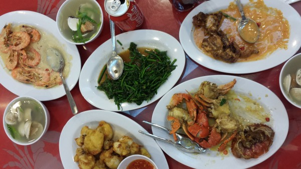 Dinner spread including the famous and delicious Sabah vegetable.