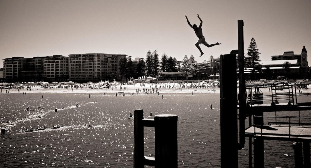 """""""Summer is all about spending time with friends near the water and having a bucketload of fun!! I took this photo of my mate at the jetty in Glenelg last summer and to me it embodies the freedom, excitement and adventure that comes with the summer months."""" - Brian Tam"""