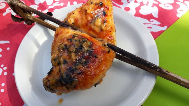 Mouthwatering Ayam Percik freshly cooked on a charcoal grill