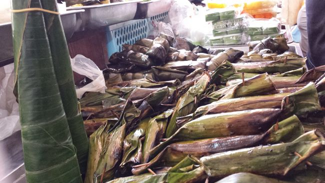 Banana leaf-wrapped snacks including Nasi Tumpang on the left - recipe in one of my previous Kelantan posts