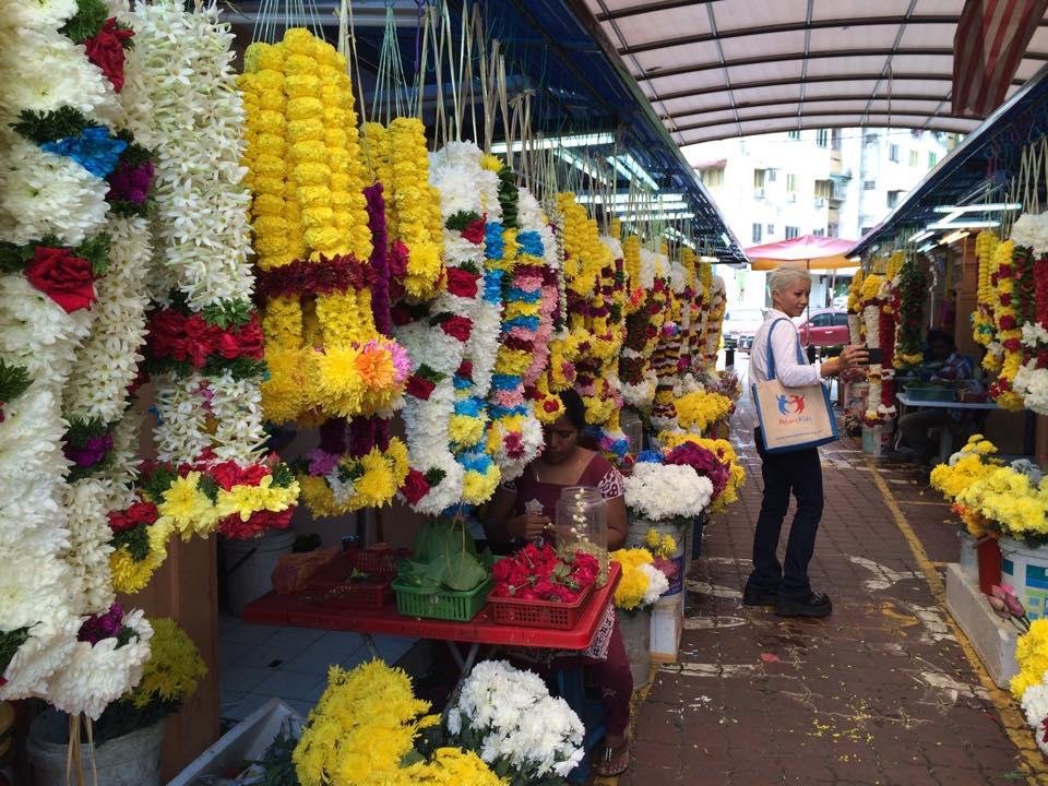 Arcade filled with flower garland stalls in Brickfields
